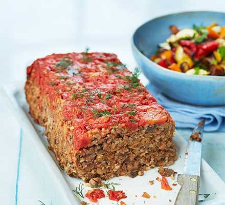 A serving plate with healthy Turkish meatloaf and a salad served alongside