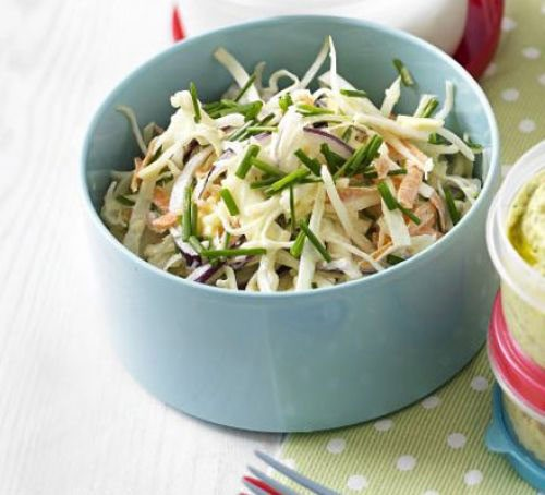 A pot of healthy cheese and chive coleslaw
