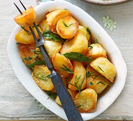 Herb-infused roast potatoes in a dish