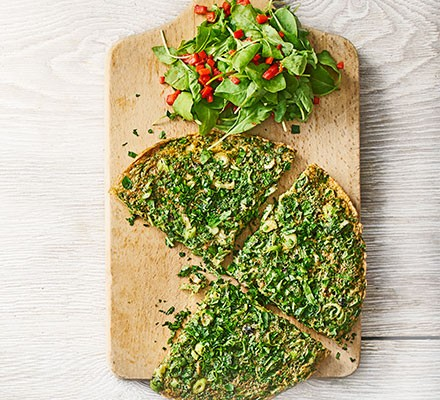 Herby Persian frittata served on a chopping board