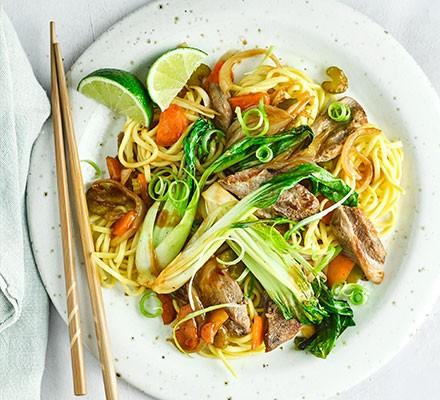 Hoisin duck stir-fry with chopsticks