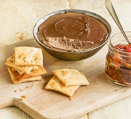 Homemade rosemary crackers served with pate and chutney