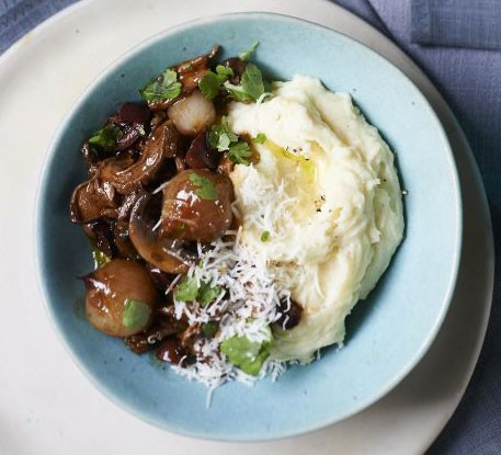 Horseradish mashed potatoes in a bowl with beef