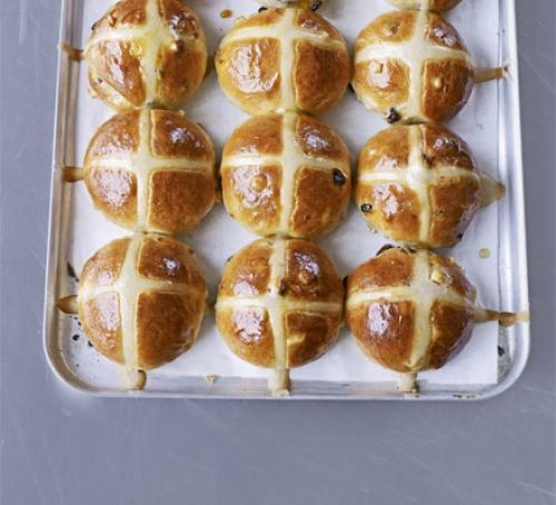 Hot cross buns baked in rows on a tray