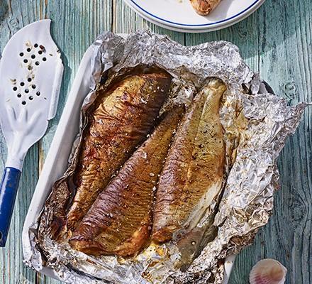 Hot tea-smoked trout with new potato & rocket salad