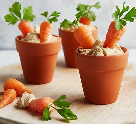 Veg patch hummus served in decorative flower pots