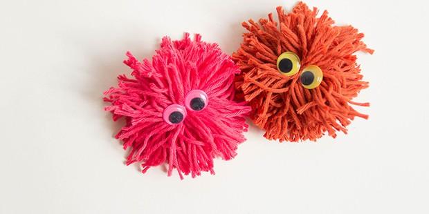 Two homemade pom-pom monsters