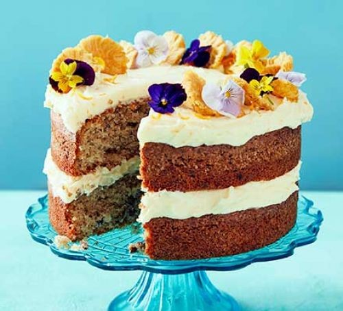 Hummingbird layer cake with edible flower topping