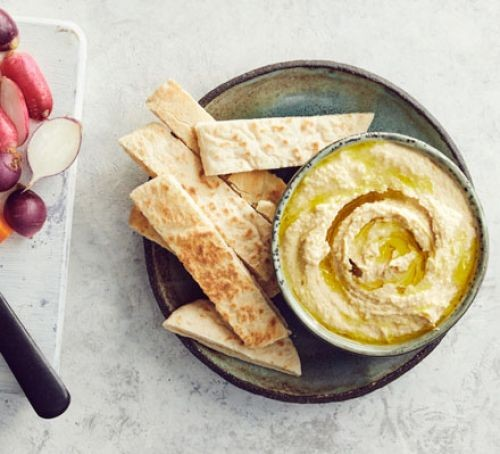 hummus with sliced pitta bread