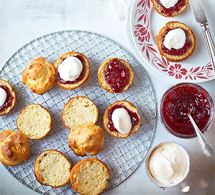 A wire rack serving ice cream scones with jam