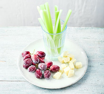 A plate serving iced grapes with cheddar cubes & celery