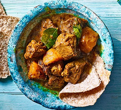 Lamb curry in blue bowl