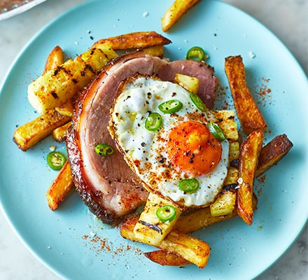 Island-style ham, pineapple egg & chips served on a blue plate