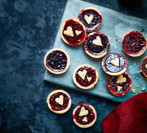 Jam tarts with heart pastry topping