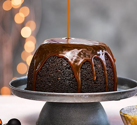 Jamaican ginger sponge pudding served on a cake stand