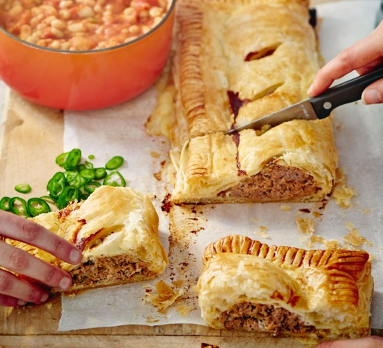 Jumbo sausage roll with salsa beans