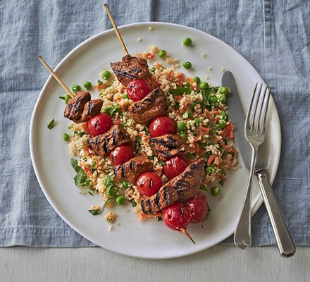 Spiced lamb kebabs with pea & herb couscous