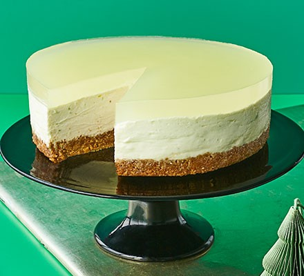 A cake stand serving a layered lime cheesecake