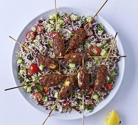 Spicy lamb & feta skewers with Greek brown rice salad