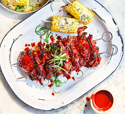 Korean chilli, sesame & honey chicken served on a platter with sweetcorn