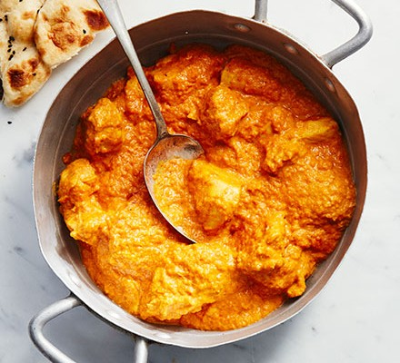Slow cooker chicken korma served in a pan