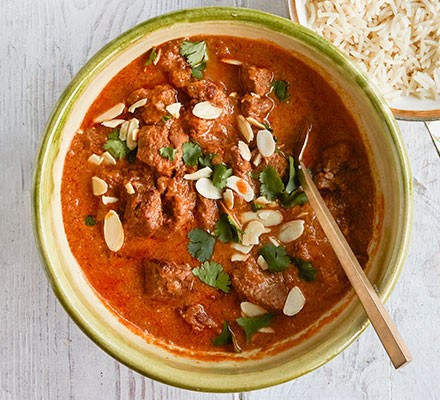 Easy slow cooker lamb curry served in a pot