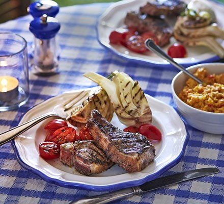 Marinated grilled lamb cutlets with creamed corn