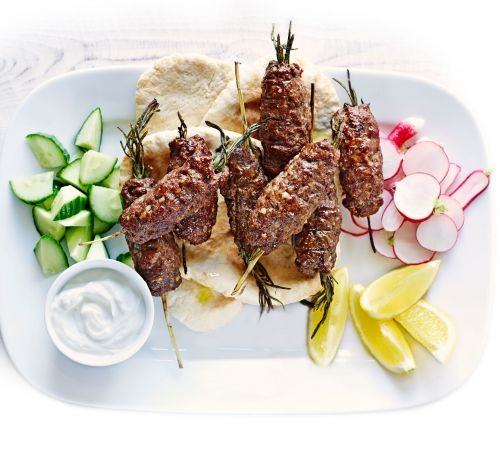 Lamb kofta skewers with flatbreads, yogurt and chopped vegetables