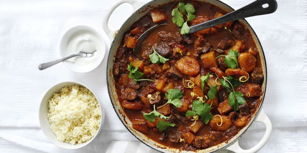 Lamb, squash and apricot tagine in a large pot with couscous on side