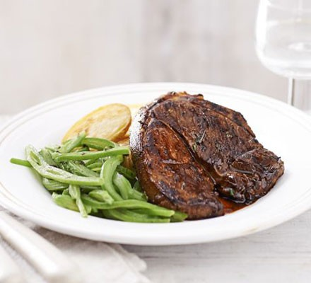 Lamb steaks with crispy potatoes & minted beans