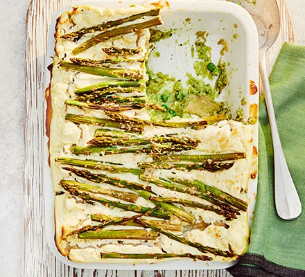 Asparagus & broad bean lasagne served in a casserole dish