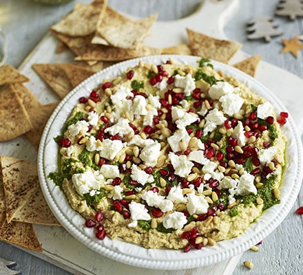 Layered hummus with spiced tortilla chips