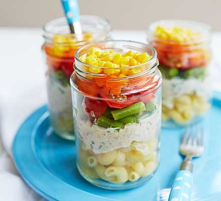 Three jars filled with rainbow salad pots