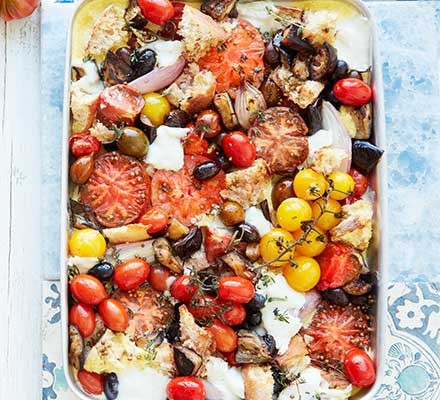 Lazy summer tomato & sourdough traybake served in a roasting dish