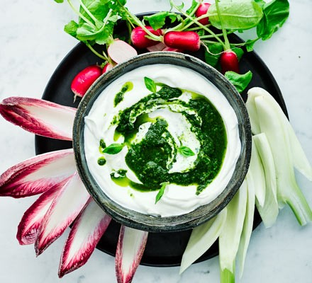 Leafy salsa verde with yogurt in a bowl with veg