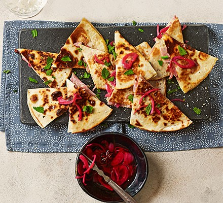 Christmas ham quesadilla served with sweet pickled onions