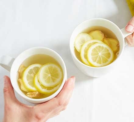 Lemon & ginger tea served in two teacups