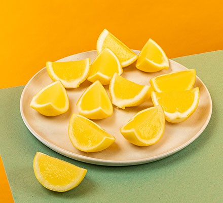 A collection of lemon drop jellies on a plate