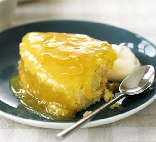 Lemon sponge pudding on a plate with ice cream