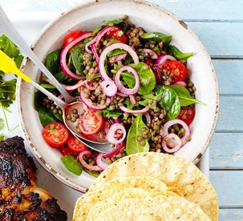 Bowl of lentil, tomato, onion and salad