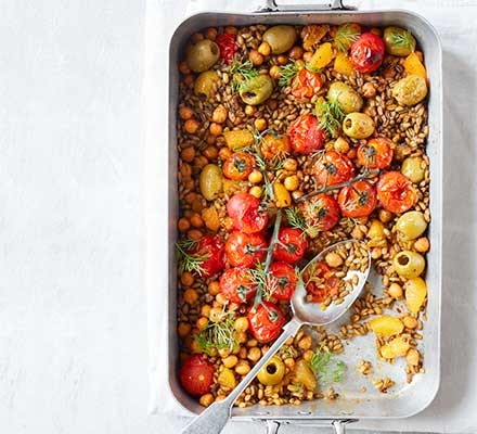 Moroccan freekeh traybake served in a roasting tin