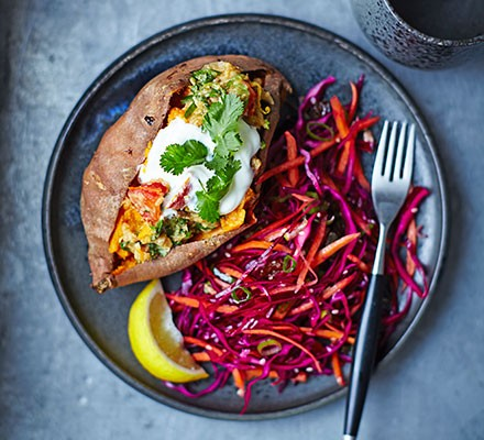 Baked sweet potatoes with lentils & red cabbage slaw