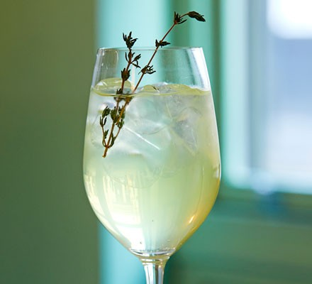 Limoncello spritz cocktail in glass with thyme
