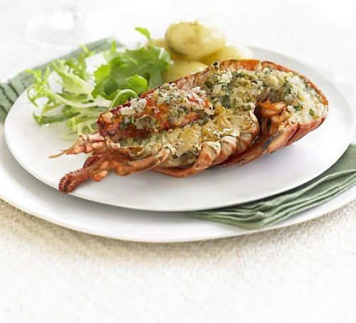 grilled lobster with Thermidor butter, new potatoes and salad