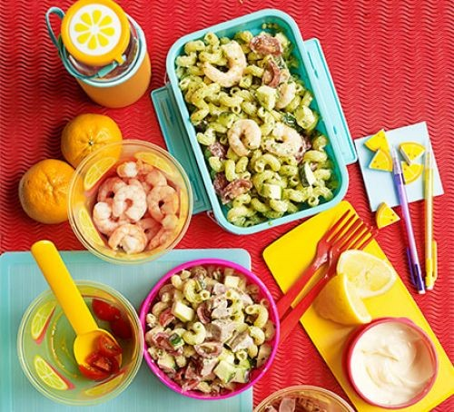 Pasta salad in different shaped colourful lunchbox