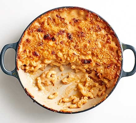 A casserole dish serving mac 'n' cheese with Marmite