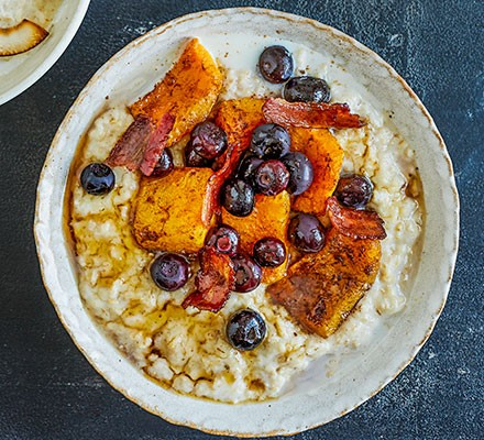 Porridge topped with maple squash, bacon & blueberry