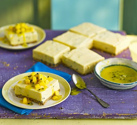 Maracuja (passion fruit mousse traybake) cut into squares, with one slice served on a plate