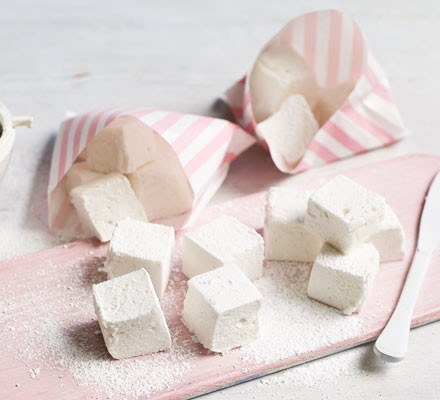 Marshmallows on board with paper bags