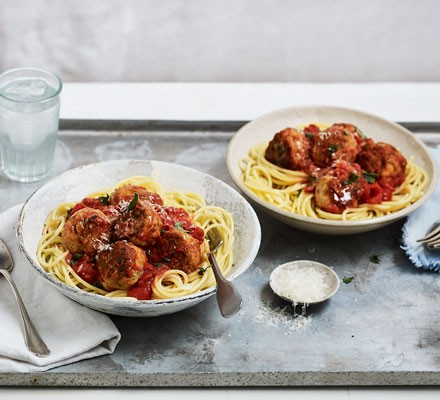 Spaghetti with meatballs in bowls
